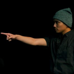 male actor pointing on stage